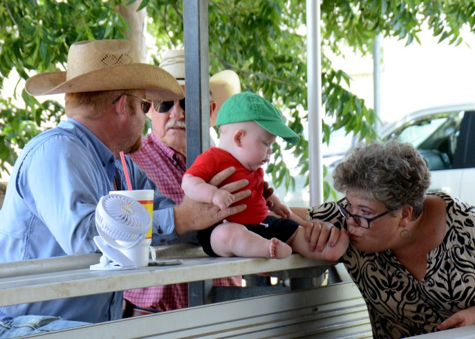 Three generations enjoy the Market Swine Show at the Central Texas Youth Fair, Wednesday June 4.