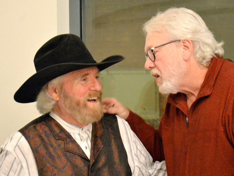Michael Martin Murphey takes photos with fans after his concert at the Bosque Arts Center.