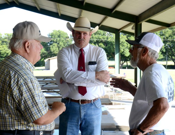 "Candidate Clint Pullin listens to voters at the Bosque County Republican Party's pre-runoff election ""Party In The Park"" at the Bosque Bottoms Pavilion June 16."