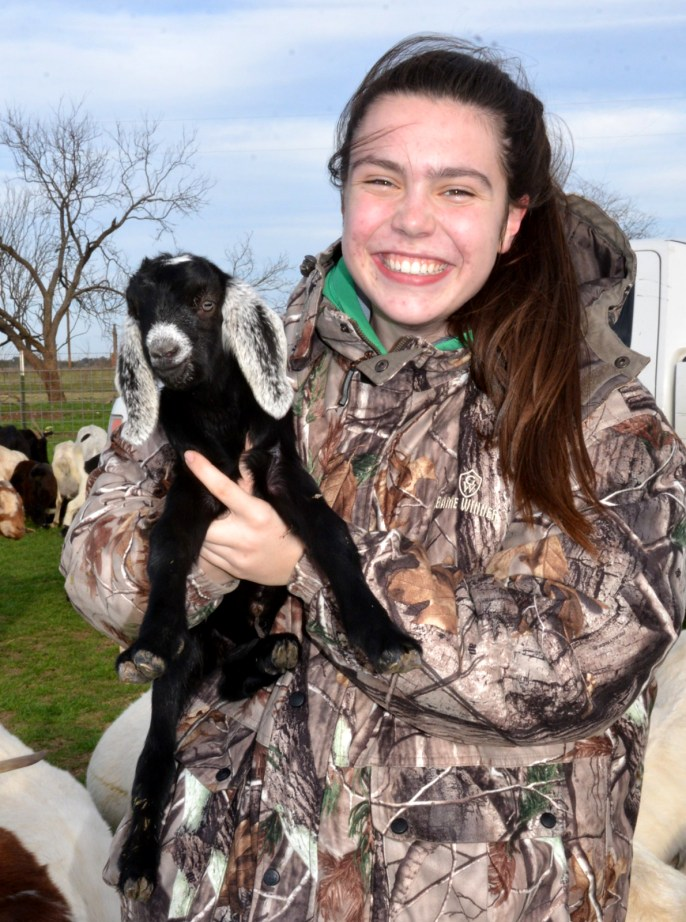 Dacey Dieteker with a day-old goat kid born to a first-time mom in 2019.