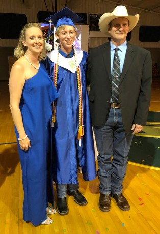 Brandy and Clint Pullin with son Matthew at his Walnut Springs High School graduation.