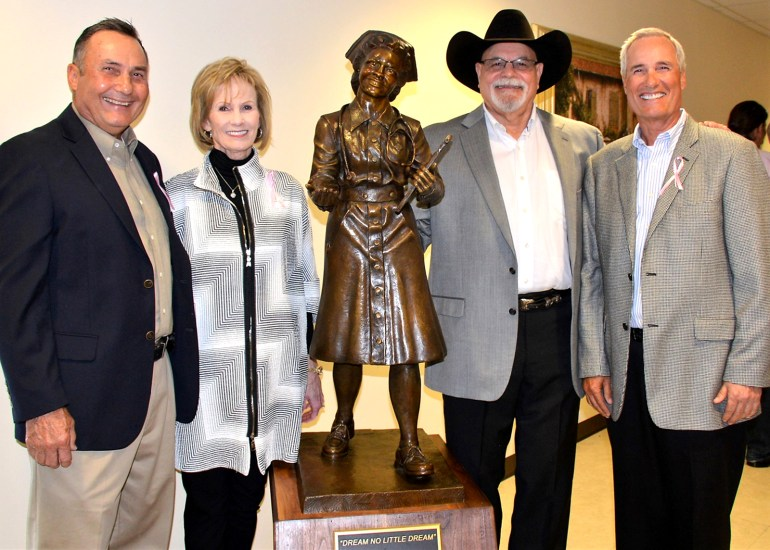 "Jack Walker with John Wiggins, Marie Wiggins Collier, and Jack Wiggins after the unveiling of the Fern Johnson Wiggins' R.N. sculpture in the Goodall-Witcher foyer in 2018. The statue named ""Dream no Little Dream"" honored a committed nursing career spanning 37 ½ years, and is dedicated to all healthcare professionals who had, have and will play a vital role at Goodall-Witcher Hospital."