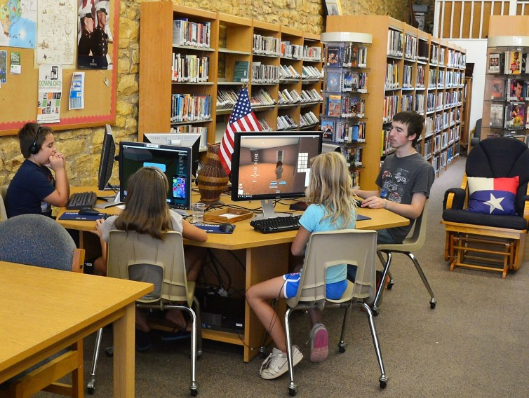 Youth utilize the Meridian Public Library computers for homework and research. The library is a fixed school bus stop.