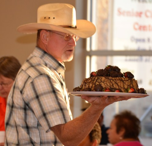 Paul Hardcastle assists with the popular and lucrative cake auction during the Meridian Public Library Fall Chili Supper.