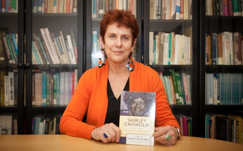 Project Director, Barbara Winslow holding her new Chisholm biography.