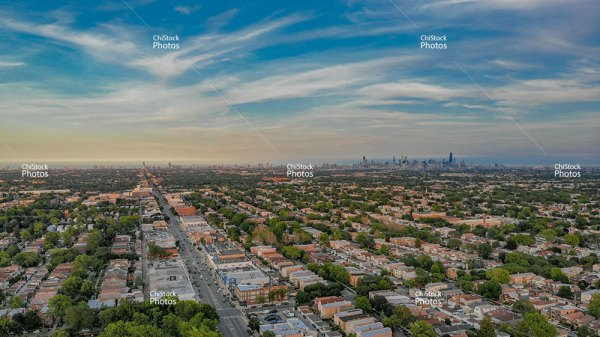 Aerial Drone View Portage Park Neighborhood With Chicago Skyline In The Background