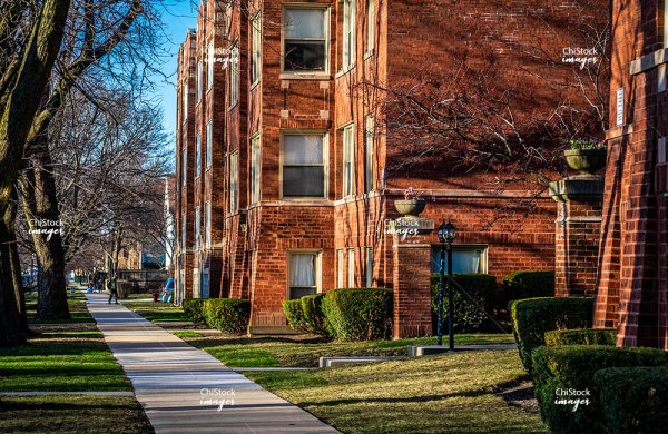 Sidewalk View of Courtyard Apartments in Irving Park Chicago