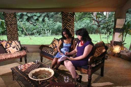 Bridget Osborne With Zeinab Badawi discussing scripts in our makeshift studio in Tanzania