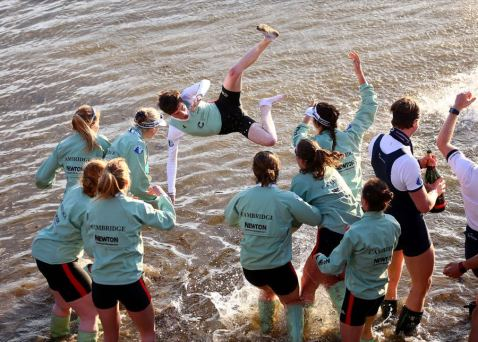 LONDON, ENGLAND - APRIL 02: The Cambridge women's crew celebrate winning the Cancer Research UK Women's Boat Race by throwing Matthew Holland, cox of The Cambridge women's crew into the river on April 2, 2017 in London, England. (Photo by Jordan Mansfield/Getty Images)