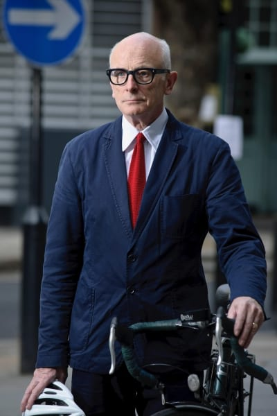 Peter Murray in a suit, with his bike _ web
