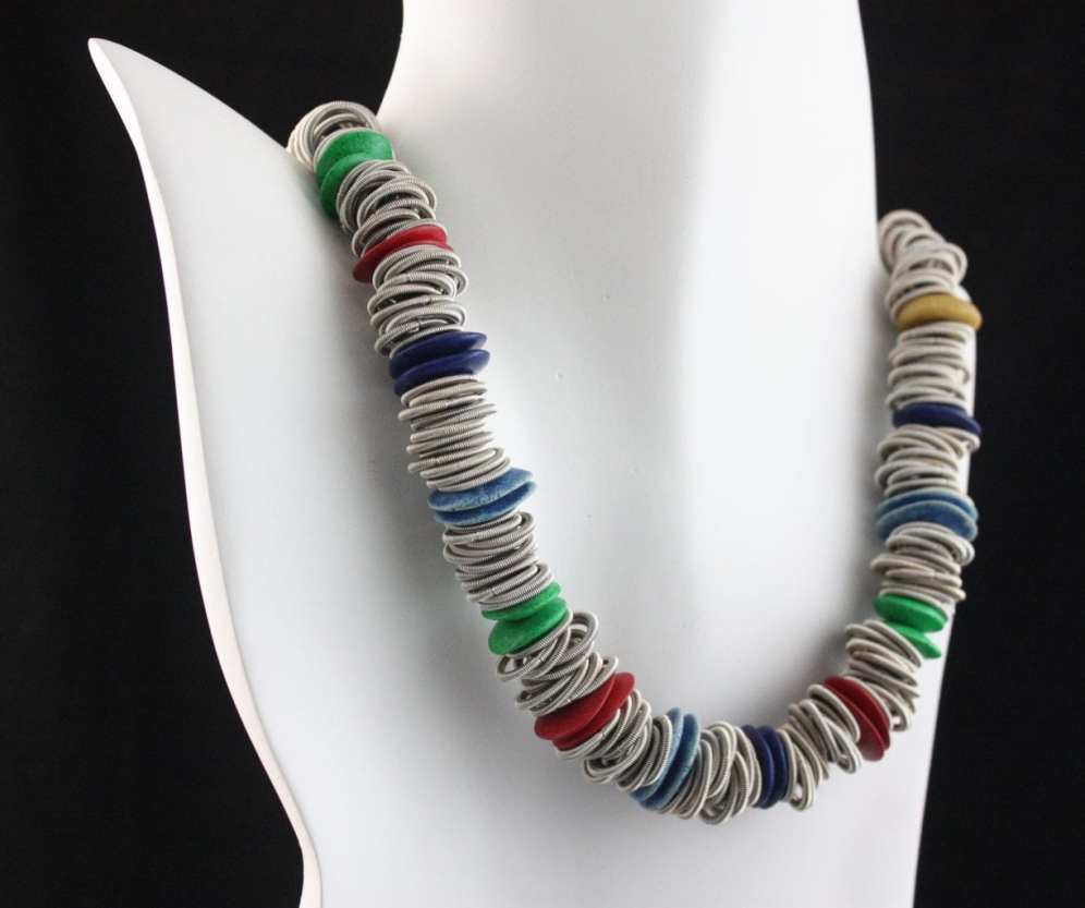 Necklace made with piano wire and ceramic by Felicity Gail