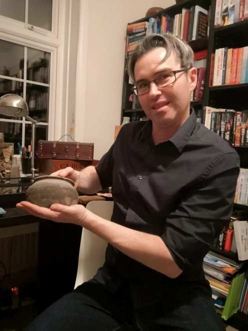 Jason holds a 2,000 year old Roman pot