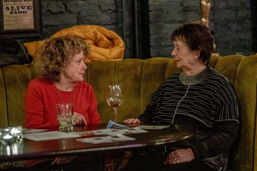 Maggie Dobson (left) deep in conversation