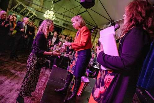 Ruth Cadbury MP awarding Cook Book festival co-founder Jo Pratt an 'Order of the Chiswick Empire'