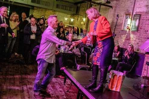 Ruth Cadbury MP awarding RNLI Helmsman Glen Monroe an 'Order of the Chiswick Empire'