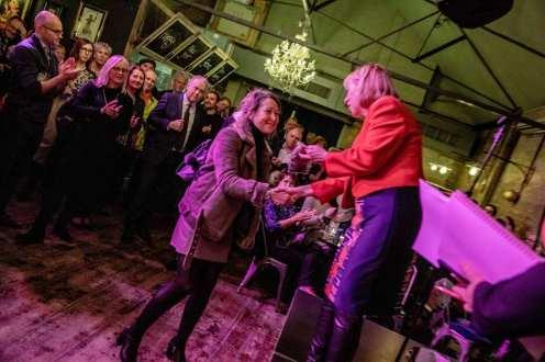 Ruth Cadbury MP awarding Rhian Williams an 'Order of the Chiswick Empire'