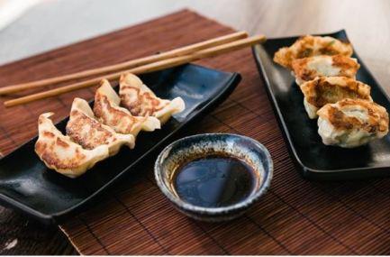 Hare & Tortoise - Pan-fried chicken dumplings (left) chive and shrimp dumplings (right)