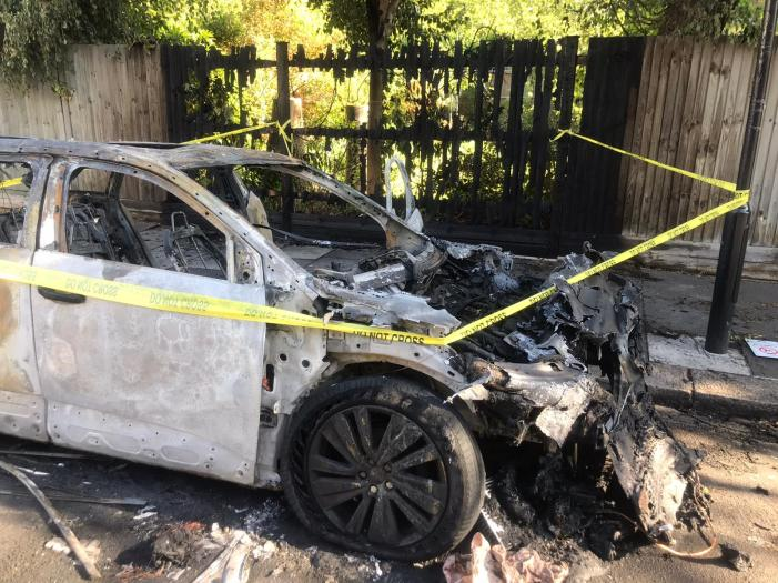 Burnt out car - front