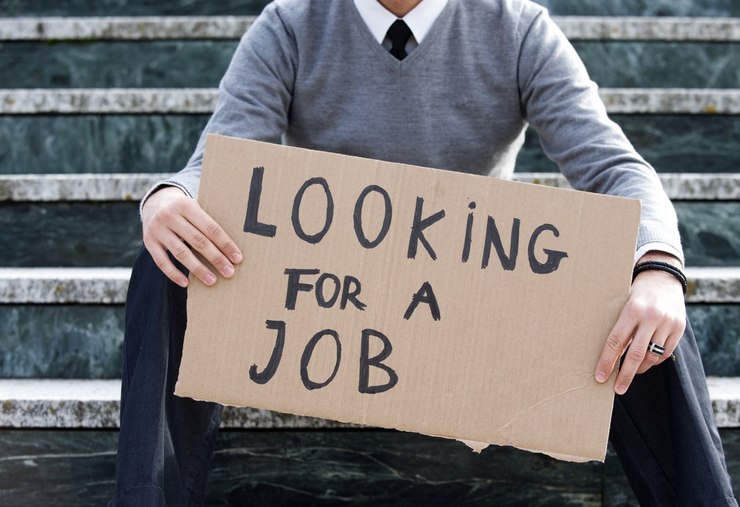 Unemployment image - boy holding a sign