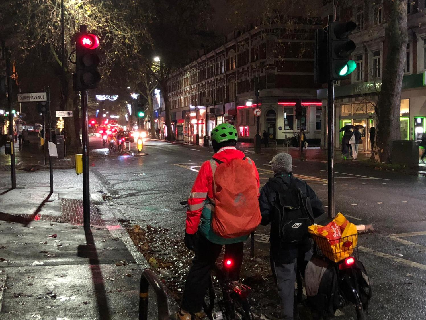 Cyclists waiting at the light