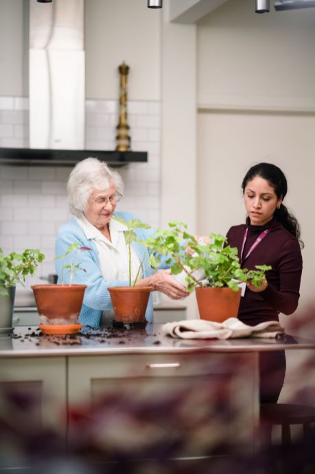 Home Instead carer helping with plants_web