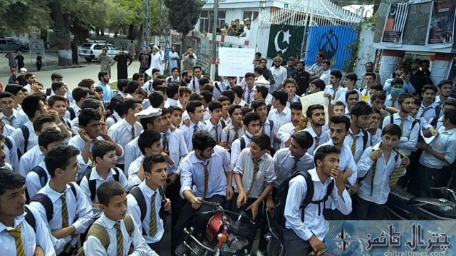 Students and teachers of the langland school and college chitral protest against Miss carry 11