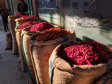 Sacks and sacks of chilis in a market in New Delhi, India