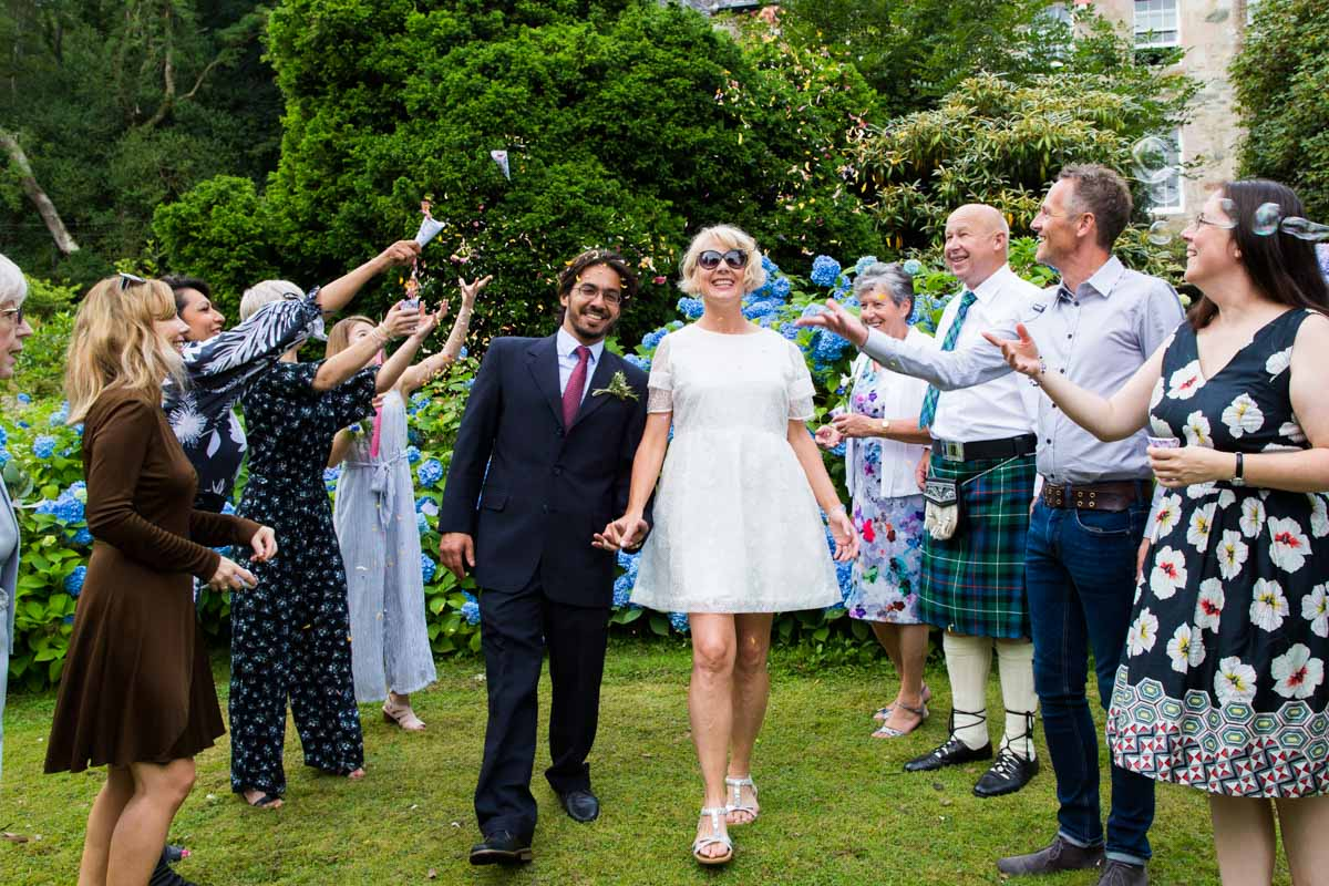 Bride and groom confetti line at Old Kilmun House. Scotland wedding photographer. Dunoon wedding photography.