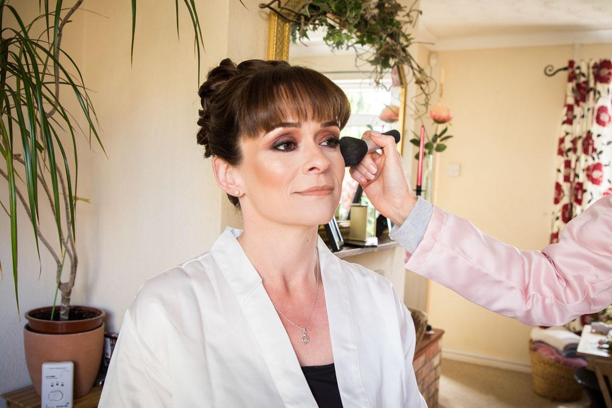 Bridal makeup being applied, Scotland wedding photographer.