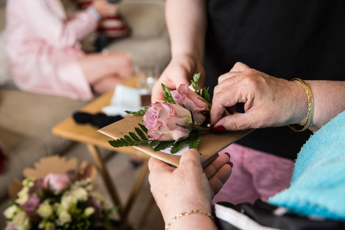 Bluebell Wood Florist Tewkesbury. Pink buttonhole. Wedding photographer Loch Lomond