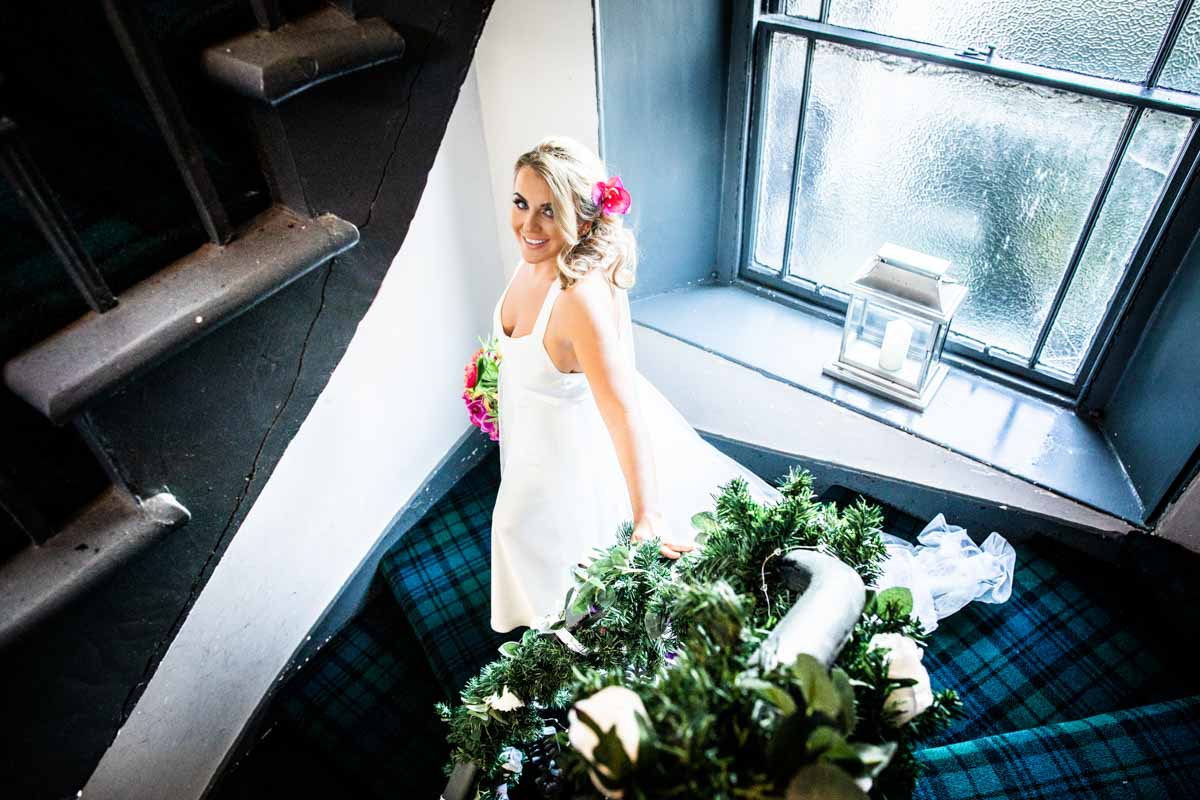 Bride on tartan staircase at The Dumbuck Hotel