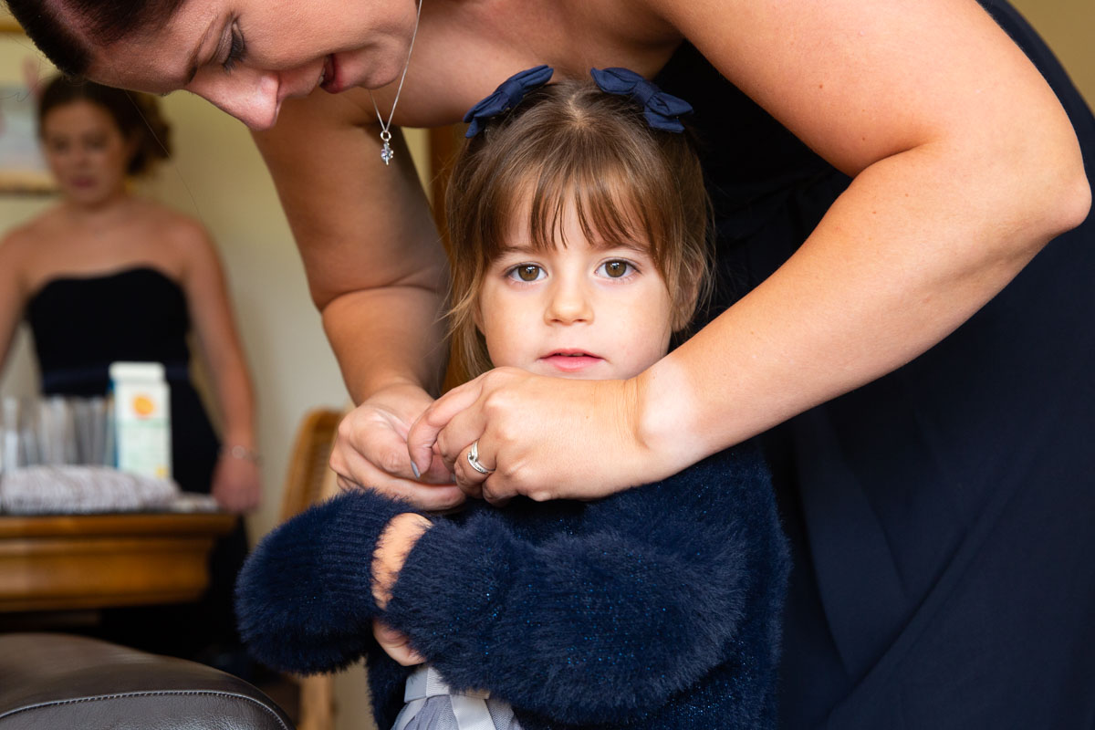 Navy flower girl at MacDonald Forest Hills Hotel & Spa