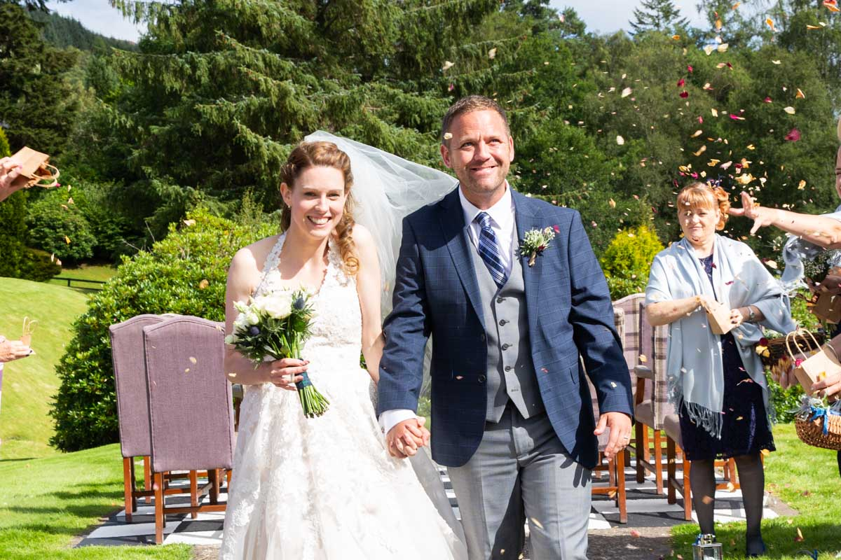 Outdoor wedding ceremony with confetti at MacDonald Forest Hills Hotel