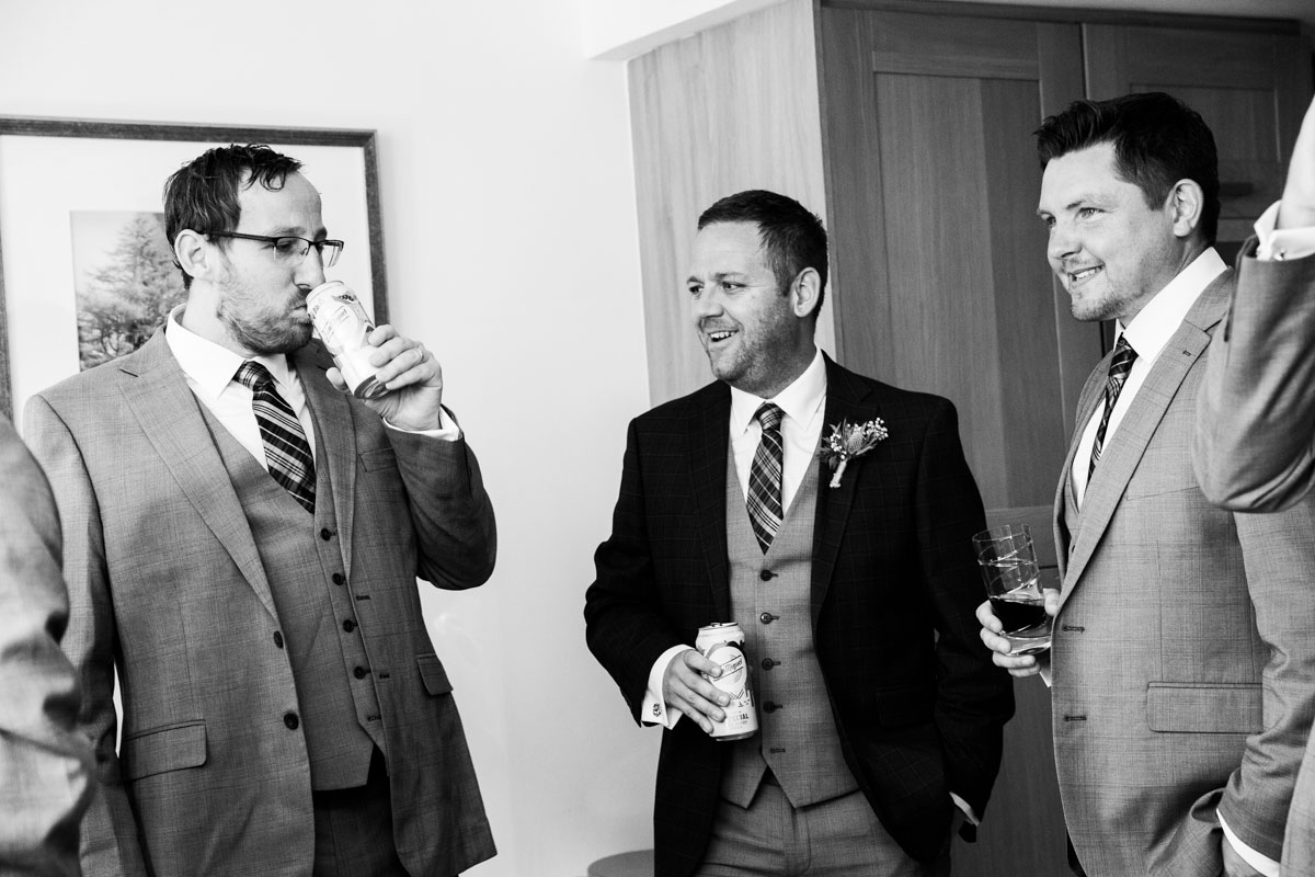 Groom and ushers on the morning of the wedding at MacDonald Forest Hills Hotel wedding