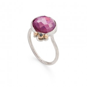 rose cut ruby set in a sterling silver ring with 9ct gold detail and a black diamond £250