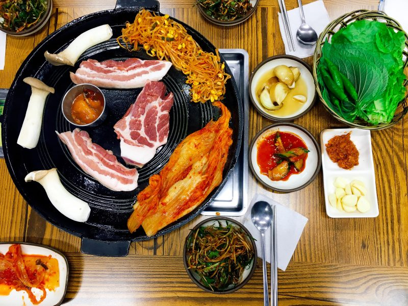 """A Foodie's Guide: Korean BBQ for Dummies - A Korean BBQ classic is samgyupsal, translates into """"three-layered meat,"""" referring to the marbling of the pork belly. 