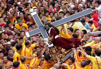 Devotees carry the statue of the Black Nazarene during the start of an annual procession in Manila. The Black Nazarene, a life-size wooden statue of Jesus Christ carved in Mexico and brought to the Philippines in the 17th century, is believed to have healing powers in the predominantly Roman Catholic country. It is paraded through the narrow streets of Manila's old city from dawn to midnight. Police said about 500,000 people joined the procession on Wednesday. (Erik De Castro/Reuters)