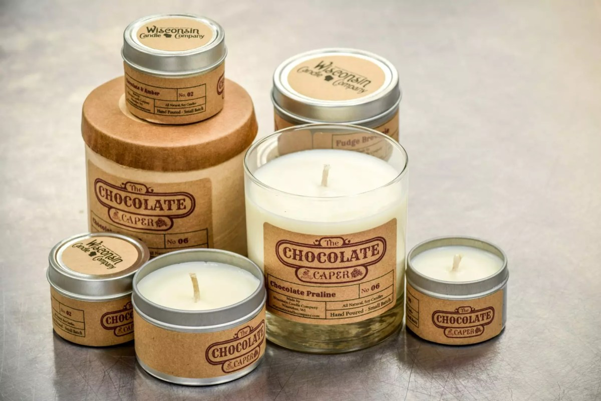 A variety of 2oz, 4oz and 10oz candles arranged decoratively on top of each other.