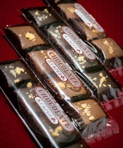 Four sleeves, two dark chocolate and two milk chocolate, each containing four pieces of chocolate dipped toffee.