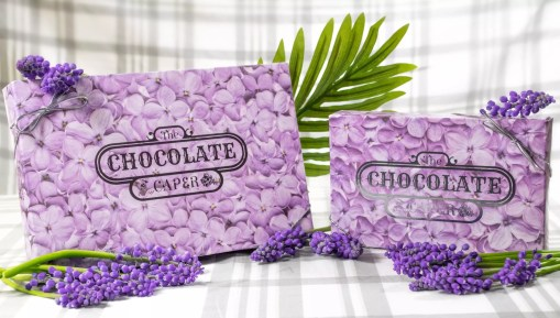 Small and large lilac-covered boxes