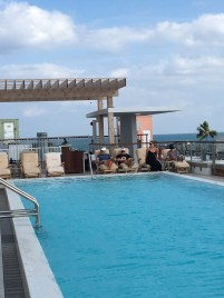 Rooftop pool with ocean in the background