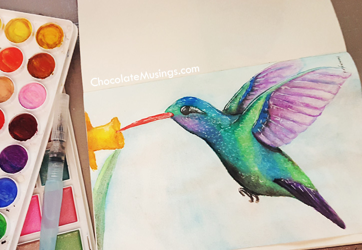 Watercolor hummingbird with paint pallets