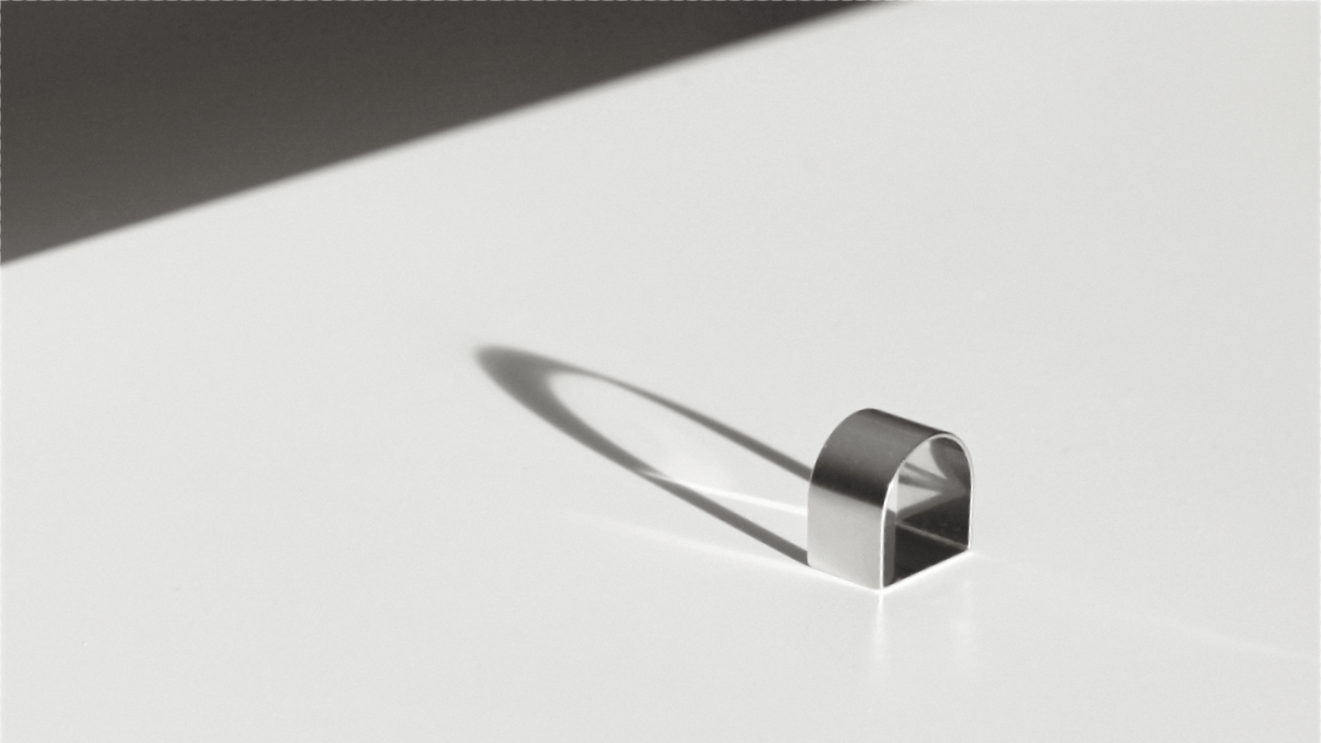 large line ring with shadows on white table