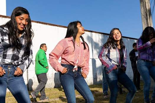 Teenagers of Macheros practive a dance.
