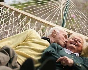 Elderly couple on hammock