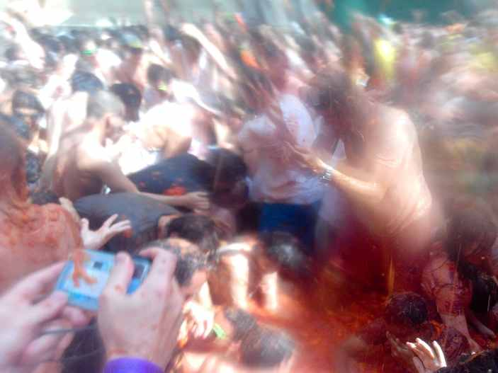Tomato fight at La Tomatina in Bunol, Spain.