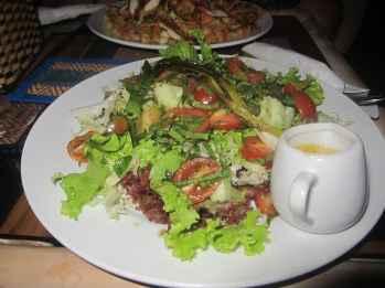 Feta, tomato, and onion salad in Phnom Penh, Cambodia. It came with no feta, no onion, and, accidentally, Corey's Caesar dressing.