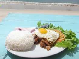Pork lok lak on the beach in Sihanoukville, Cambodia.