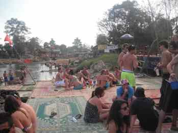 Drinking by the river in Vang Vieng, Laos.