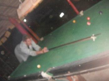 Playing pool at Rock Bar in Vang Vieng, Laos.